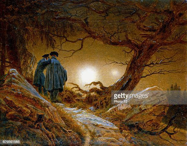 Caspar David Friedrich German painter Romantic  Man and Woman Gazing at the Moonc1824New Moon with earthshine phenomenon described by Samuel Taylor...