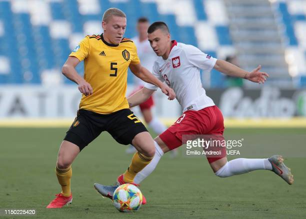 Casper De Norre of Belgium is challenged by Konrad Michalak of Poland during the 2019 UEFA U-21 Group A match between Poland and Belgium at Mapei...