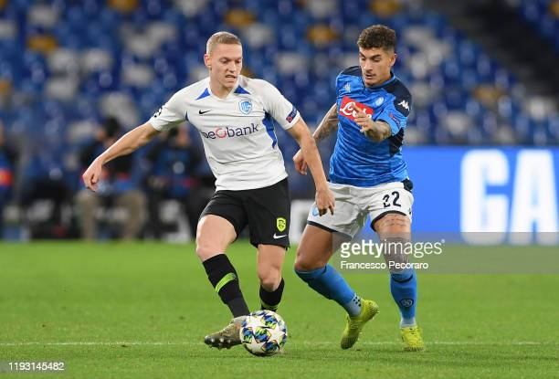 Casper De Norre of KRC Genk vies with Giovanni Di Lorenzo of SSC Napoli during the UEFA Champions League group E match between SSC Napoli and KRC...