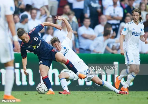 Casper Hojer Nielsen of AGF Aarhus and Robert Skov of FC Copenhagen $copm$ the Danish Alka Superliga Europa League Playoff match between FC...