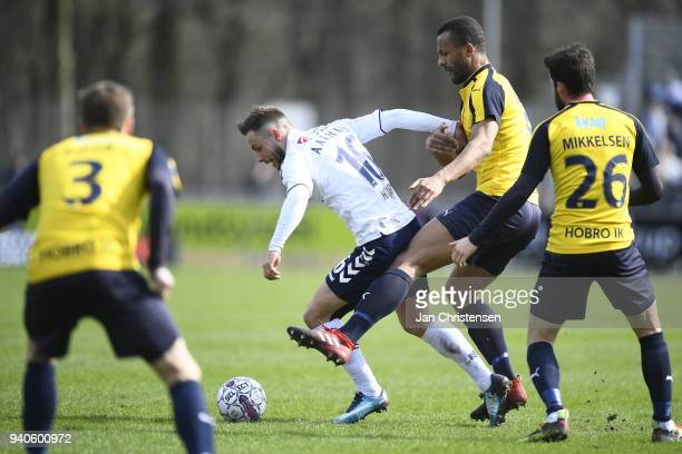 Casper Hojer Nielsen of AGF Aarhus and YawIhle Amankwah of Hobro IK compete for the ball during the Danish Alka Superliga match between Hobro IK and...
