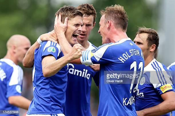 Casper Johansen of Kiel celebrates after scoring their first goal during the Third Bundesliga match between Holstein Kiel and 1 FC Saarbruecken at...