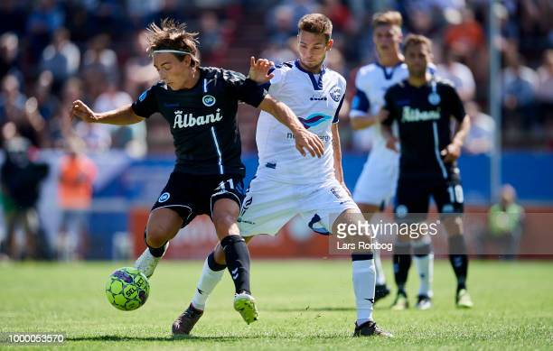 Casper Nielsen of OB Odense and Mikkel Frankoch of Vendsyssel FF compete for the ball during the Danish Superliga match between Vendsyssel FF and OB...