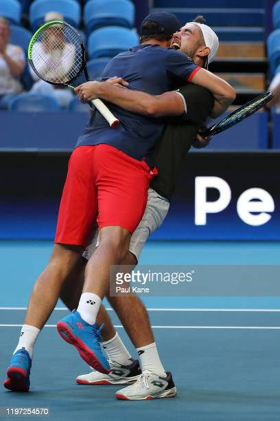 Casper Ruud and Viktor Durasovic of Team Norway celebrate defeating Austin Krajicek and Rajeev Ram of Team USA in the doubles and to win the tie...
