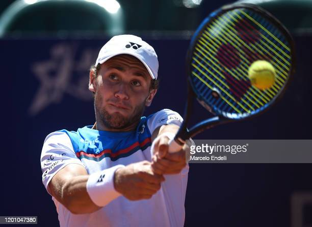 Casper Ruud of Norway hits a backhand during his Men's Singles match against Juan Ignacio Londero of Argentina as part of first semifinal during day...