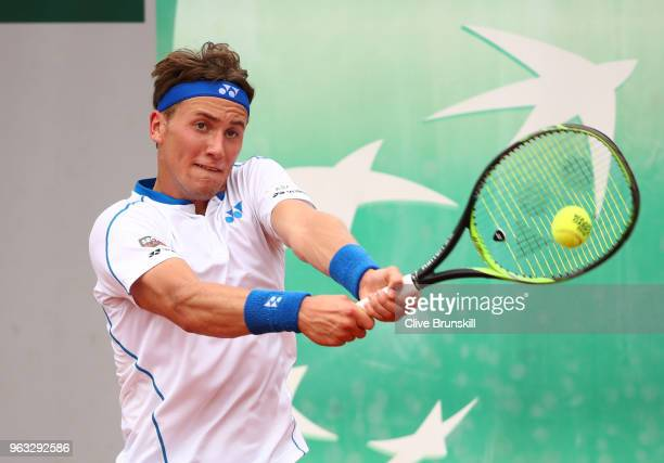 Casper Ruud of Norway plays a backhand during his mens singles first round match against Jordan Thompson of Australia during day two of the 2018...
