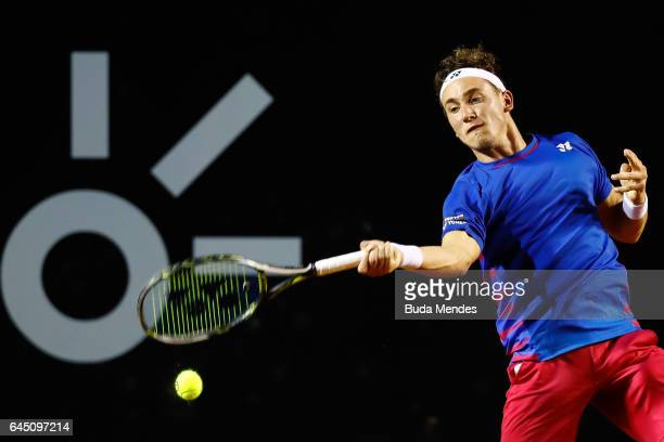 Casper Ruud of Norway returns a shot to Thiago Monteiro of Brazil during the quarter finals of the ATP Rio Open 2017 at Jockey Club Brasileiro on...