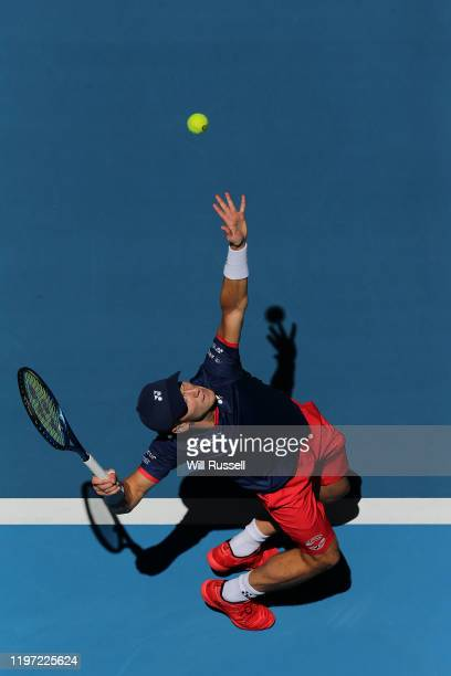 Casper Ruud of Norway serves to John Isner of USA in the mens singles match during day one of the 2020 ATP Cup Group Stage at RAC Arena on January...