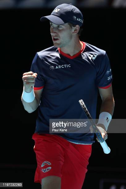 Casper Ruud of Team Norway celebrates winning a point in the tie break in his singles match against John Isner of Team USA during day one of the 2020...