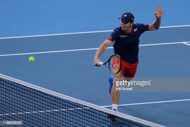 Casper Ruud of Team Norway plays a backhand in the doubles match against Konstantin Kravchuk and Teymuraz Gabashvili of Team Russia during day five...