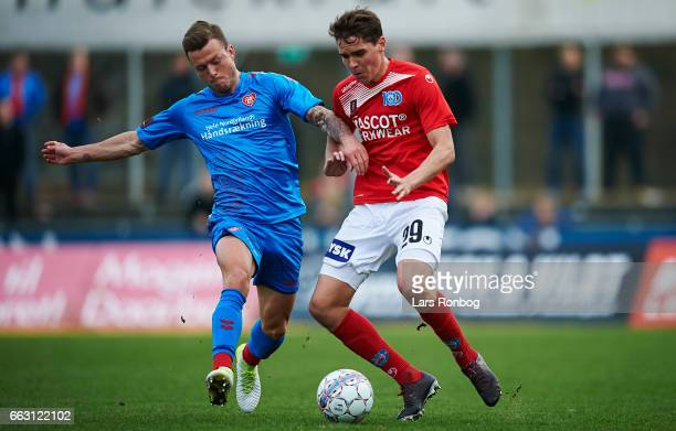 Casper Sloth of AaB Aalborg and Robert Skov of Silkeborg IF compete for the ball during the Danish Alka Superliga match between Silkeborg IF and AaB...