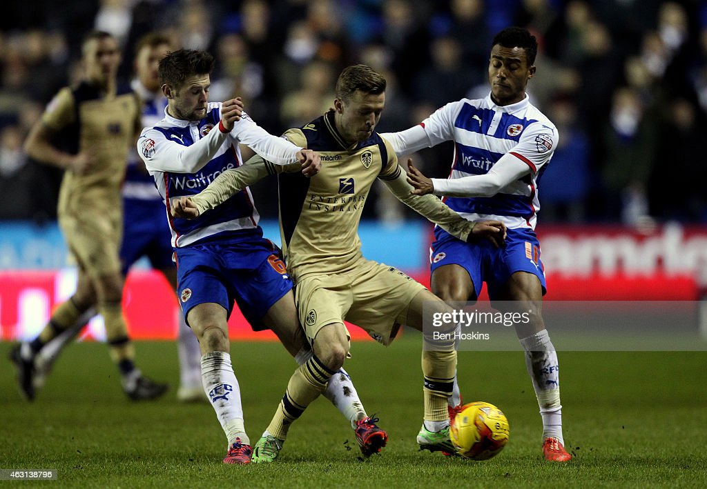 Casper Sloth of Leeds holds off pressure from Oliver Norwood of Reading and Jordan Obita of Reading during the Sky Bet Championship match between Reading and Leeds United at Madejski Stadium on February 10, 2015 in Reading, England.
