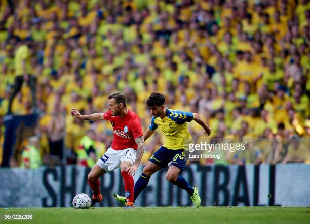 Casper Sloth of Silkeborg IF and Besar Halimi of Brondby IF compete for the ball during the Danish DBU Pokalen Cup Final match between Brondby IF and...