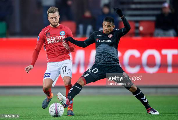 Casper Sloth of Silkeborg IF and Edison Flores of AaB Aalborg compete for the ball during the Danish Alka Superliga match between Silkeborg IF and...