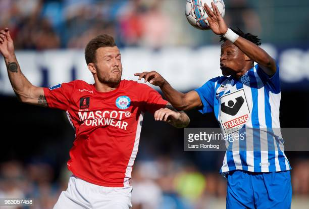 Casper Sloth of Silkeborg IF and Emmanuel Oti Essigba of Esbjerg fB compete for the ball during the Danish Alka Superliga Playoff match between...