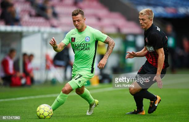 Casper Sloth of Silkeborg IF and Rasmus Nissen of FC Midtjylland compete for the ball during the Danish Alka Superliga match between FC Midtjylland...