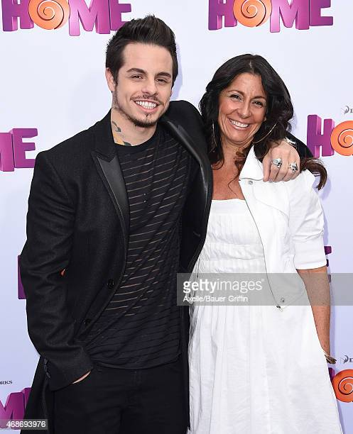 Casper Smart and mom Shawna Lopaz arrive at the Los Angeles premiere of 'HOME' at Regency Village Theatre on March 22 2015 in Westwood California