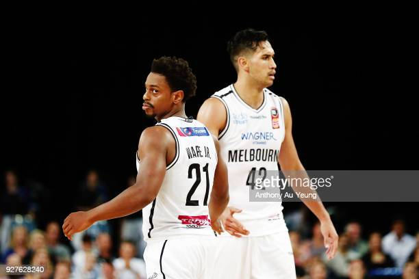 Casper Ware and Tai Wesley of United celebrate during game two of the NBL semi final series between Melbourne United and the New Zealand Breakers at...