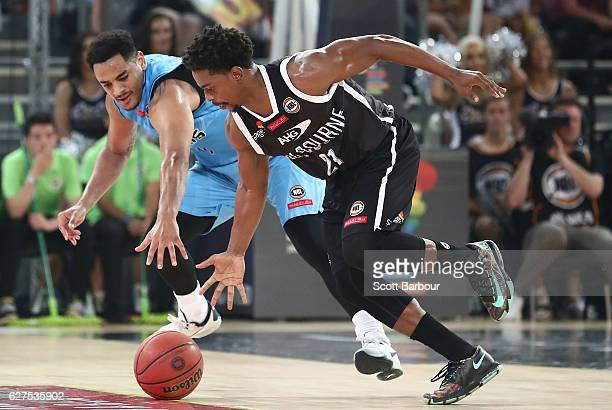 Casper Ware of Melbourne United and Corey Webster of the New Zealand Breakers compete for the ball during the round nine NBL match between Melbourne...