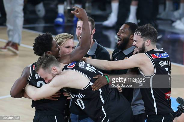 Casper Ware of Melbourne United and his teammates celebrate winning game five of the NBL Grand Final series between Melbourne United and the Adelaide...