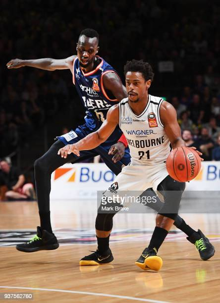 Casper Ware of Melbourne United and Majok Deng of the Adelaide 36ers during game four of the NBL Grand Final series between the Adelaide 36ers and...