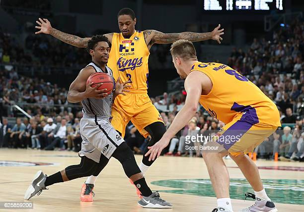 Casper Ware of Melbourne United drives to the basket as Greg Whittington of the Sydney Kings defends during the round eight NBL match between...