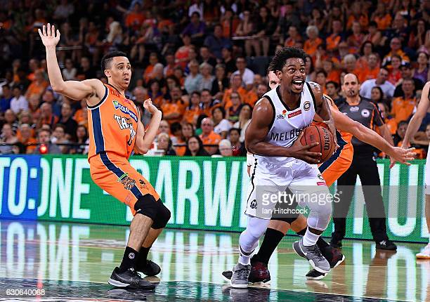 Casper Ware of Melbourne United drives to the basket past Travis Trice of the Taipans during the round 13 NBL match between Cairns and Melbourne on...