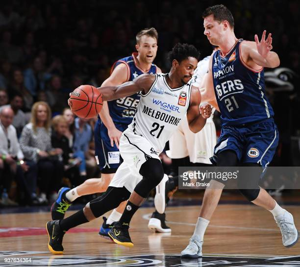 Casper Ware of Melbourne United drives towards Daniel Johnson of the Adelaide 36ers during game four of the NBL Grand Final series between the...