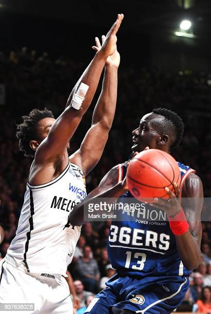 Casper Ware of Melbourne United guards Majok Deng of the Adelaide 36ers during game four of the NBL Grand Final series between the Adelaide 36ers and...