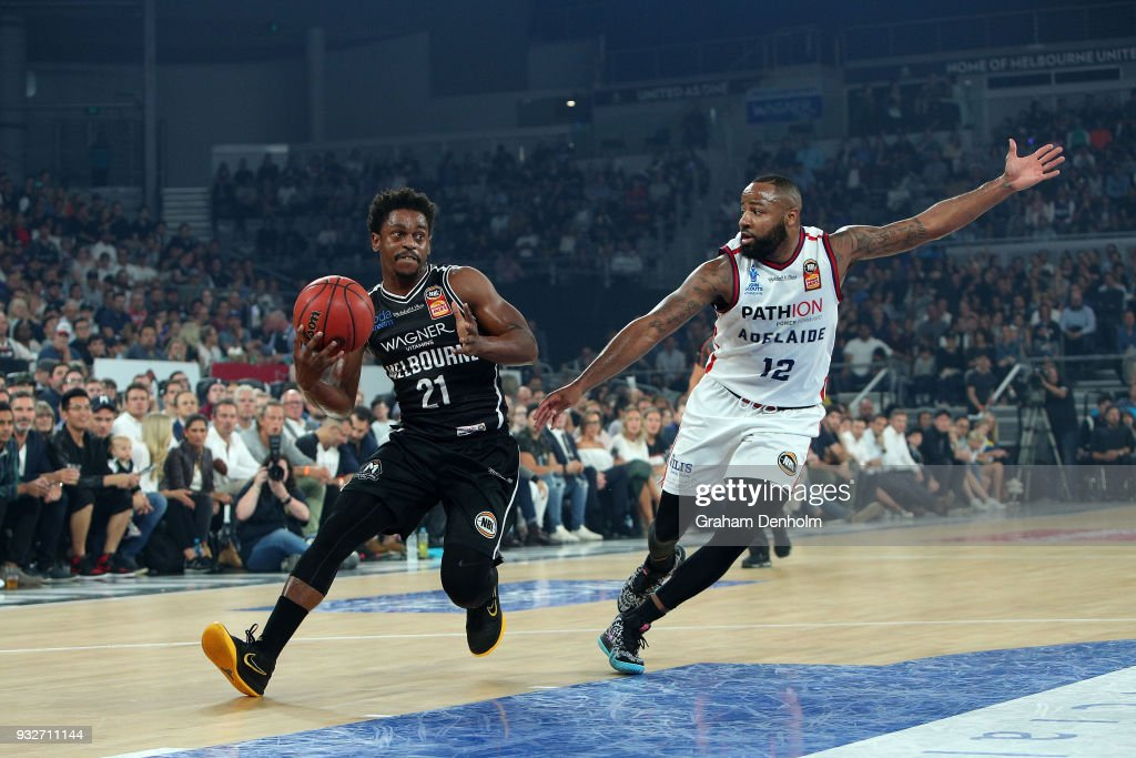 Casper Ware of Melbourne United (L) is challenged by Shannon Shorter of the Adelaide 36ers during game one of the NBL Grand Final series between Melbourne United and the Adelaide 36ers at Hisense Arena on March 16, 2018 in Melbourne, Australia.