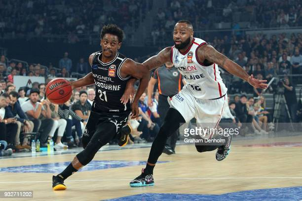 Casper Ware of Melbourne United is challenged by Shannon Shorter of the Adelaide 36ers during game one of the NBL Grand Final series between...