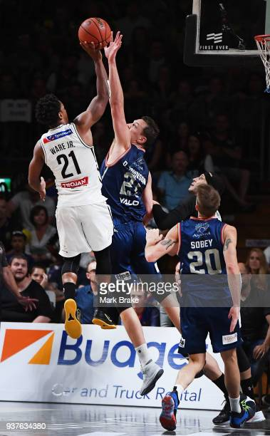 Casper Ware of Melbourne United shoots over Daniel Johnson of the Adelaide 36ers during game four of the NBL Grand Final series between the Adelaide...