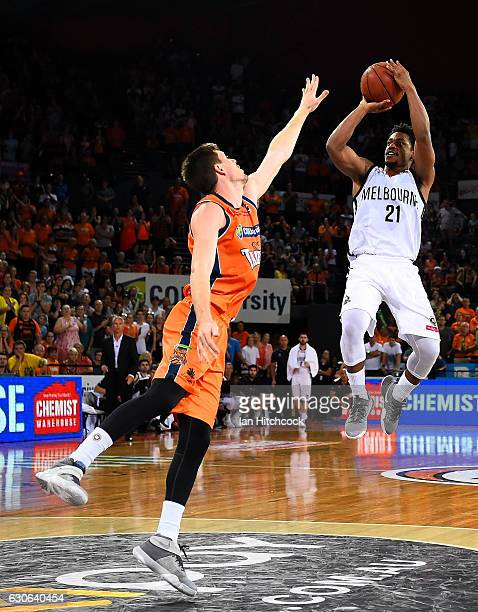 Casper Ware of Melbourne United takes a jump shot over Cam Gliddon of the Taipans during the round 13 NBL match between Cairns and Melbourne on...