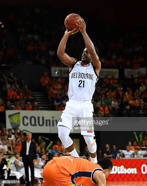 Casper Ware of Melbourne United takes a jump shot over Travis Trice of the Taipans during the round 13 NBL match between Cairns and Melbourne on...
