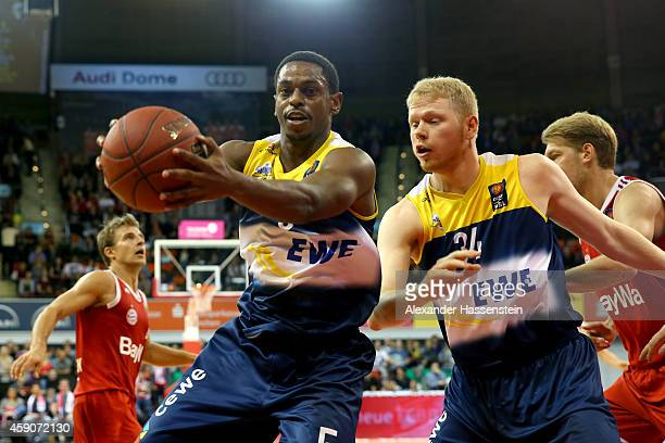 Casper Ware of Oldenburg and his team mate Philipp Neumann battle for the ball during the Beko Basketball Bundesliga match between FC Bayern Muenchen...