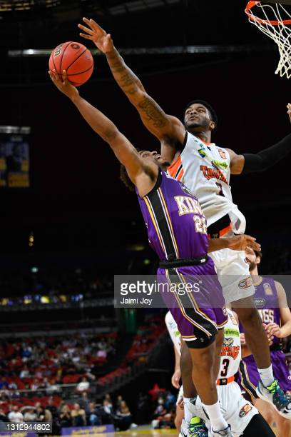 Casper Ware of Sydney Kings is fouled by Cameron Oliver of Cairns Taipans during the round 14 NBL match between the Sydney Kings and the Cairns...