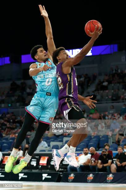 Casper Ware of the Kings drives to the basket and is fouled by Tai Webster of the Breakers during the NBL Cup match between the Sydney Kings and the...