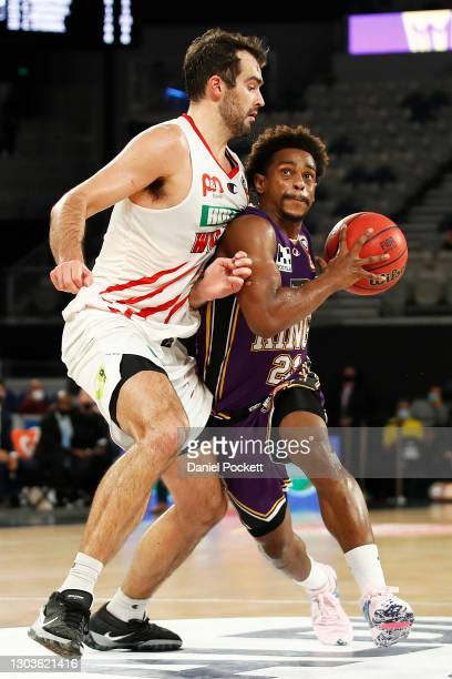 Casper Ware of the Kings drives to the basket under pressure from John Mooney of the Wildcats during the NBL Cup match between the Sydney Kings and...