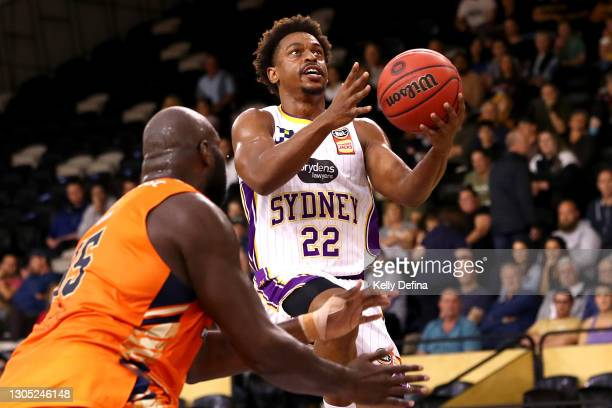 Casper Ware of the Kings drives to the basket under pressure from Nathan Jawai of the Taipans during the NBL Cup match between the Cairns Taipans and...