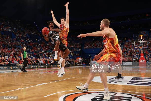 Casper Ware of the Kings goes to the basket against Will Magnay of the Wildcats during the round 20 NBL match between the Perth Wildcats and the...