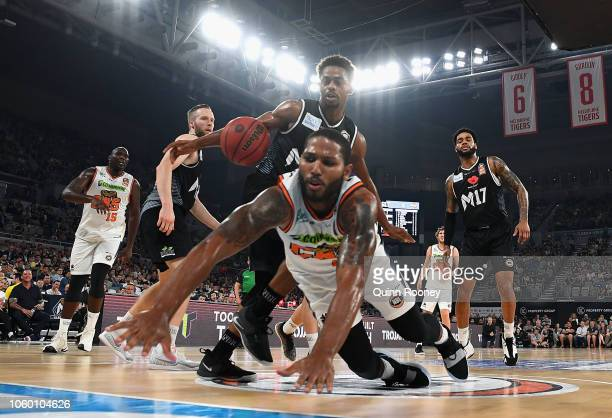 Casper Ware of United and Dj Newbill of the Taipans compete for the ball during the round five NBL match between Melbourne United and the Cairns...
