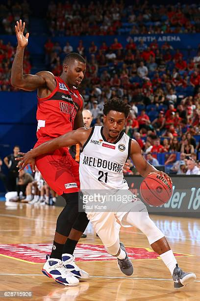 Casper Ware of United drives to the basket against Casey Prather of the Wildcats during the round 10 NBL match between the Perth Wildcats and...