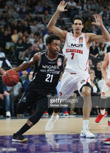 Casper Ware of United drives to the basket past Oscar Forman of the Hawks during the round eight NBL match between Melbourne United and the Illawarra...