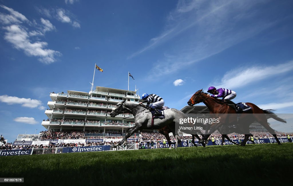 Caspian Prince (L) riding by Tom Eaves wins The Investec Corporate Banking âDashâ Handicap Stakesduring the Investec Derby Day at Epsom Downs Racecourse on June 3, 2017 in Epsom, England.