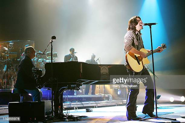 """Cass Dillon performs the new Billy Joel song """"Christmas in Fallujah"""" with Billy Joel at the Sears Centre December 1, 2007 in Chicago, Illinois."""