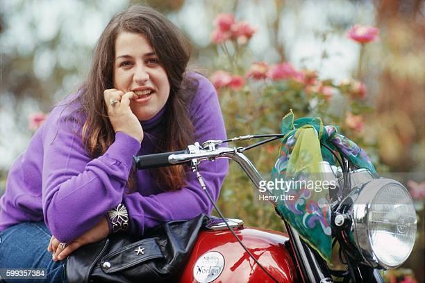 Cass Elliot on a Norton Motorcycle