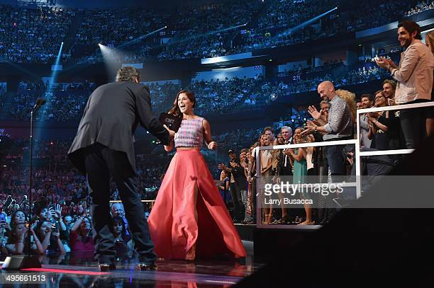 Cassadee Pope accepts an award onstage from Blake Shelton at the 2014 CMT Music awards at the Bridgestone Arena on June 4 2014 in Nashville Tennessee