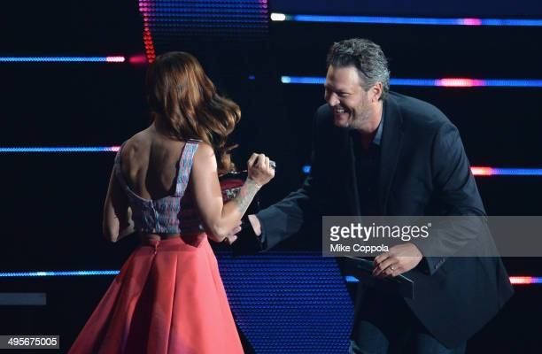 Cassadee Pope and Blake Shelton onstage during the 2014 CMT Music awards at the Bridgestone Arena on June 4 2014 in Nashville Tennessee