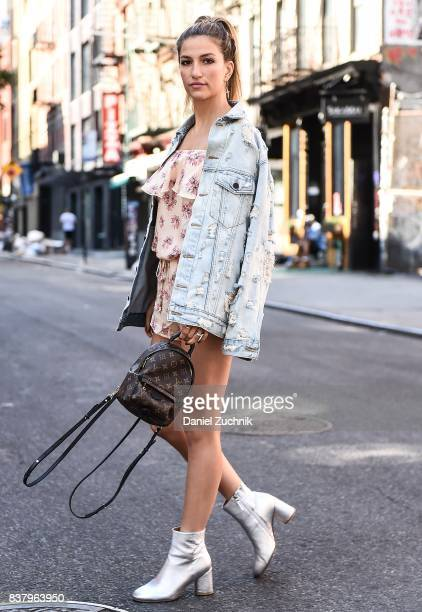 Cassandra DiMicco is seen in the Lower East Side wearing an Alexander Wang jean jacket Eberjey romper Alias Mae silver boots and Louis Vuitton...
