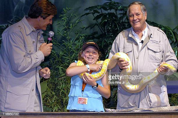 Cassandra Hovarth of Salem Virginia gets wrapped up in a tenfoot albino Burmese python with Peter Gros and Jim Fowler of Mutual of Omaha's Wild...